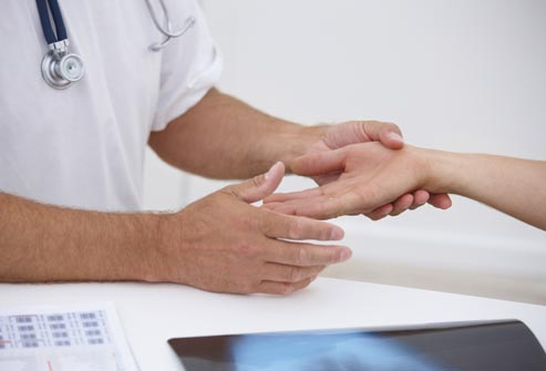 photolibrary_rf_photo_of_doctor_examining_hand